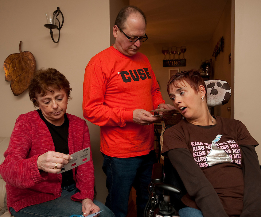 Kara exchanges cards with her parents before a family dinner on Valentines Day. Photo by James R. Evans©