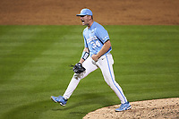 North Carolina Tar Heels relief pitcher Caden O'Brien (34) reacts after getting the final out in the game against the South Carolina Gamecocks at Truist Field on April 6, 2021 in Charlotte, North Carolina. (Brian Westerholt/Four Seam Images)