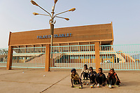 NIGER Niamey, soccer stadium PALAIS DU 29 JUILLET, children with self made plastic  tin shed toy cars