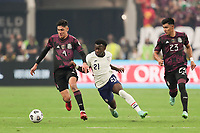 LAS VEGAS, NV - AUGUST 1: Edson Alvarez #4 of Mexico battles for the ball with George Bello #21 of the United States during a game between Mexico and USMNT at Allegiant Stadium on August 1, 2021 in Las Vegas, Nevada.
