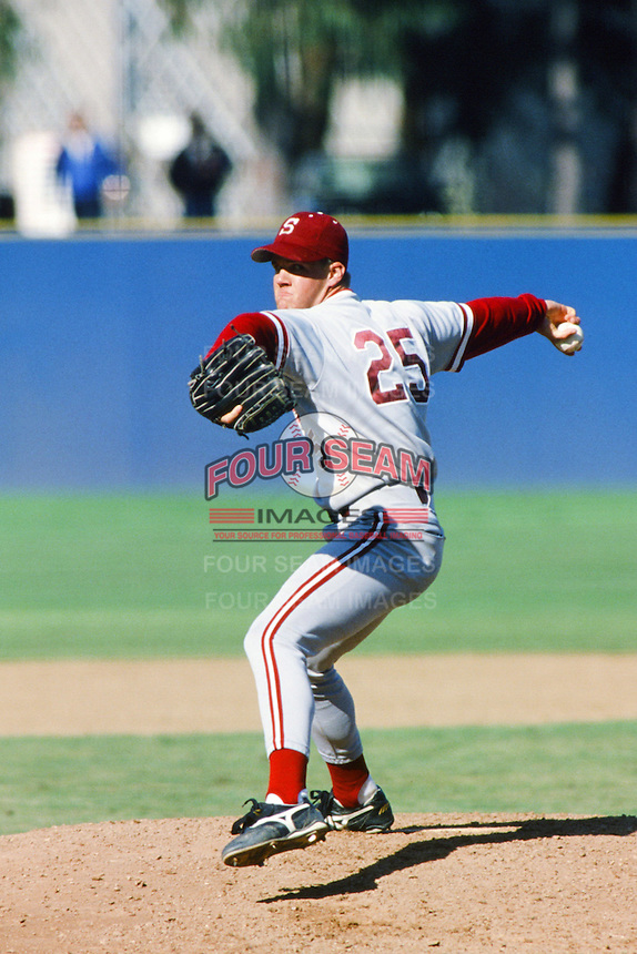 Jeff Austin of the Stanford Cardinal pitches during a 1996 NCAA baseball season game against the UCLA Bruins at Jackie Robinson Stadium in Los Angeles, California. (Larry Goren/Four Seam Images)