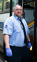New York, New York City. New Yorkers are told to stay home during the corona virus, (COVID-19) so New York has become eerily empty. MTA bus driver.