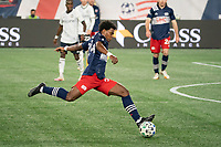 FOXBOROUGH, MA - OCTOBER 19: DeJuan Jones #24 of New England Revolution takes a shot on goal during a game between Philadelphia Union and New England Revolution at Gillette on October 19, 2020 in Foxborough, Massachusetts.