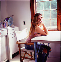 Woman sitting at kitchen table<br />