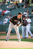 Ryan Arrowood (18) of the Albuquerque Isotopes looks to his catcher for the sign against the Salt Lake Bees in Pacific Coast League action at Smith's Ballpark on June 8, 2015 in Salt Lake City, Utah.  The Bees defeated the Isotopes 10-7 in game one of a double-header.Stephen Smith/Four Seam Images)