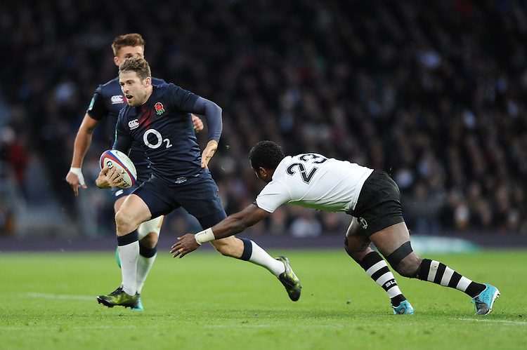 Elliot Daly of England goes round Kini Murimurivalu of Fiji during the Old Mutual Wealth Series match between England and Fiji at Twickenham Stadium on Saturday 19th November 2016 (Photo by Rob Munro)