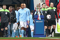 Vincent Kompany of Manchester City (centre) leads out the Manchester City team ahead of the Capital One Cup match between Liverpool and Manchester City at Wembley Stadium, London, England on 28 February 2016. Photo by David Horn / PRiME Media Images.
