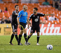 Santino Quaranta (25) and Austin Da Luz (3) of D.C. United argue with referee Jasen Anno during the game at RFK Stadium in Washington, DC.  D.C. United tied Toronto FC, 3-3.
