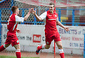 Stirling's Jordan White (right) celebrates with Stirling's Craig Comrie (8) after he scores their first goal.