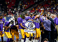 ATLANTA, GA - DECEMBER 7: LSU players celebrate after the game during a game between Georgia Bulldogs and LSU Tigers at Mercedes Benz Stadium on December 7, 2019 in Atlanta, Georgia.