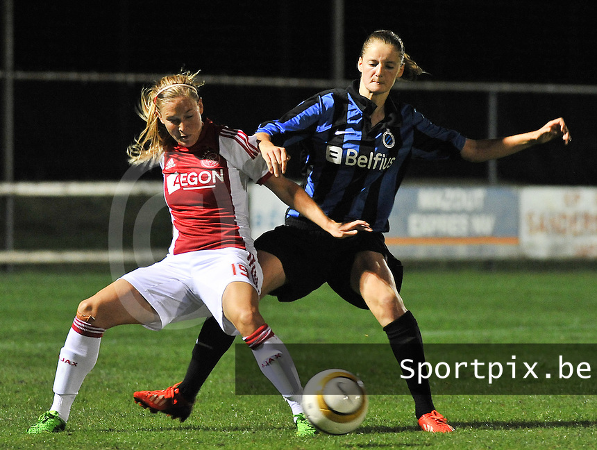 20130830 - VARSENARE , BELGIUM : Ajax' Claudia Van den Heiligenberg (left) pictured protecting the ball for Brugge's Bieke Vandenbussche during the female soccer match between Club Brugge Vrouwen and Ajax Amsterdam Dames , of the first matchday in the BENELEAGUE competition. Friday 30 August 2013. PHOTO DAVID CATRY