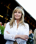 A perfect 10? Bo Derek made the winner's circle presentation to Proviso after her win in the Diana.