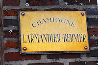 A polished brass sign saying Champagne Larmandier Bernier, Champagne Larmandier-Bernier, Vertus, Cote des Blancs, Champagne, Marne, Ardennes, France