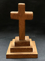 BNPS.co.uk (01202 558833)<br /> Pic: HAldridge/BNPS<br /> <br /> A poignant cross made from drift wood from the Titanic by a seaman tase with recovering the bodies from the disaster as surfaced 107 years later.<br /> <br /> The small religious symbol was delicately hand carved by Samuel Smith, a joiner on the cable-laying ship Minia which was tasked with searching for bodies.<br /> <br /> Mr Adams was so moved by the macabre experience that he honoured the victims by creating the wooden cross on a three-tiered plinth.<br /> <br /> He made it from a piece of oak wood he plucked from the ocean that has come from the sunken liner.