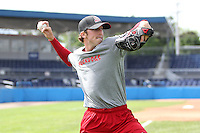 Batavia Muckdogs pitcher Corey Baker #8 throws in the outfield during practice at Dwyer Stadium on June 13, 2012 in Batavia, New York.  (Mike Janes/Four Seam Images)