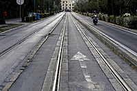 Pictured: A lone motorcyclist in an empty street.<br /> Re: Police patrol the streets to enforce the measures of self-isolation in an effort to fight the Coronavirus Covid-19 pandemic in Athens, Greece.