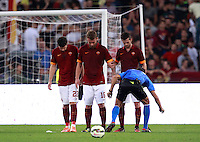 Calcio, Serie A: Roma vs ChievoVerona. Roma, stadio Olimpico, 18 ottobre 2014.<br /> Referee Gianpaolo Calvarese, right, uses vanishing spray as Roma's players, from left, Mattia Destro, Daniele De Rossi and Miralem Pjanic prepare to face a ChievoVerona's free kick during the Italian Serie A football match between Roma and ChievoVerona at Rome's Olympic stadium, 18 October 2014.<br /> UPDATE IMAGES PRESS/Isabella Bonotto