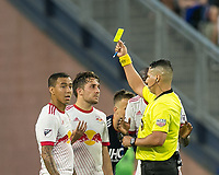 Foxborough, Massachusetts - June 2, 2018: In a Major League Soccer (MLS) match, New England Revolution (blue/white) defeated New York Red Bulls (white), 2-1, at Gillette Stadium.<br /> Yellow Card: Vincent Bezecourt