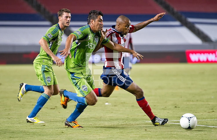 CARSON, CA - August 25, 2012: Seattle players Brad Evans (3) and Leo Gonzalez (12) and Chivas USA forward Tristan Bowen (20) during the Chivas USA vs Seattle Sounders match at the Home Depot Center in Carson, California. Final score, Chivas USA 2, Seattle Sounders 6.