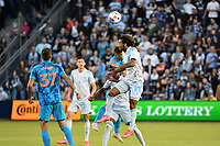 KANSAS CITY, KS - MAY 29: Gianluca Busio #10 Sporting KC heads the ball during a game between Houston Dynamo and Sporting Kansas City at Children's Mercy Park on May 29, 2021 in Kansas City, Kansas.