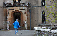 an elderly man with a walking stick at the entrance to the sightseeing tour of Dunvegan Castle in Dunvegan, Scotland on 2015/06/10. Foto EXPA/ JFK/Insidefoto