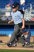Umpire Matt Carlyon during a game between the West Virginia Black Bears and Batavia Muckdogs on August 30, 2015 at Dwyer Stadium in Batavia, New York.  Batavia defeated West Virginia 8-5.  (Mike Janes/Four Seam Images)