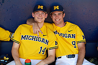 Michigan Wolverines Benjamin Keizer (14) and Matthew Schmidt (9) in the dugout before a game against Army West Point on February 17, 2018 at Tradition Field in St. Lucie, Florida.  Army defeated Michigan 4-3.  (Mike Janes/Four Seam Images)