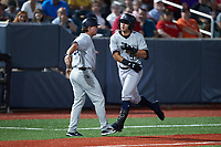 Anthony Volpe (5) of the Hudson Valley Renegades slaps hands with third base coach Aaron Bossi (93) after hitting a home run during the game against the Aberdeen IronBirds at Leidos Field at Ripken Stadium on July 23, 2021, in Aberdeen, MD. (Brian Westerholt/Four Seam Images)