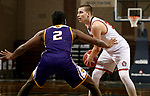 SIOUX FALLS, SD - MARCH 6: Tasos Kamateros #34 of the South Dakota Coyotes looks for a teammate while being guarded by Tamell Pearson #2 of the Western Illinois Leathernecks during the Summit League Basketball Tournament at the Sanford Pentagon in Sioux Falls, SD. (Photo by Dave Eggen/Inertia)