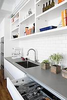 Contemporary kitchen with grey worktop
