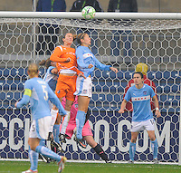 Sky Blue FC player Keeley Dowling and Red Stars player Marian Dalmy both go up for the ball on a goal kick. Sky Blue FC tied Chicago Red Stars 0-0 on April 19, 2009.