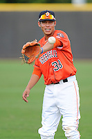 Second baseman Kristian Trompiz (38) of the Greeneville Astros warms up before a game against the Bristol Pirates on Friday, July 25, 2014, at Pioneer Park in Greeneville, Tennessee. Greeneville won, 9-4. (Tom Priddy/Four Seam Images)