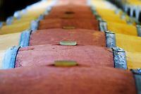 Bung hole with stopper. Oak barrel aging and fermentation cellar. Chateau Paloumey, Haut Medoc, Bordeaux, France.