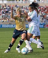 Aly Wagner battles for the ball with Mexico's Carmen Padilla..International friendly, USA Women vs Mexico, Albuquerque, NM,.October 20, 2006..USA 1, Mexico 1.