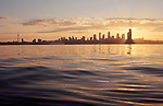 Seattle, Puget Sound, Elliott Bay,  skyline including the Space Needle from the water at sunrise,