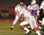 Newman running back Ronnie Vinson plows ahead for yardage during their 34-7 loss to John Curtis.