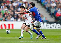 Japan Inside Centre Harumichi Tatekawa is challenged by Samoa Lock Kane Thompson - Mandatory byline: Rogan Thomson - 03/10/2015 - RUGBY UNION - Stadium:mk - Milton Keynes, England - Samoa v Japan - Rugby World Cup 2015 Pool B.