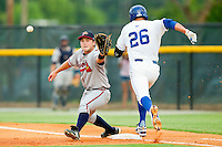 Danville Braves first baseman Casey Kalenkosky (12) stretches for a throw as Mark Threlkeld (26) of the Burlington Royals hustles down the line at Burlington Athletic Park on July 19, 2012 in Burlington, North Carolina.  The Royals defeated the Braves 4-3.  (Brian Westerholt/Four Seam Images)