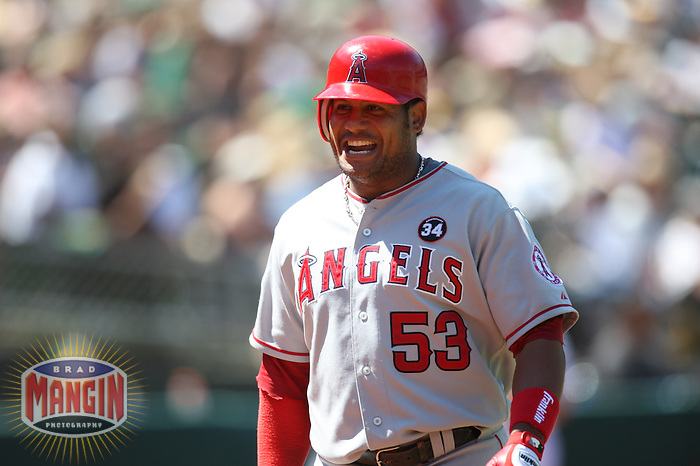 OAKLAND, CA - JULY 19:  Bobby Abreu #53 of the Los Angeles Angels of Anaheim celebrates after hitting a game-winning home run in the top of the 10th inning against the Oakland Athletics during the game at the Oakland-Alameda County Coliseum on July 19, 2009 in Oakland, California. Photo by Brad Mangin