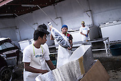 Workers pack the sustainably caught yellow fin tuna for shipment at the Casa, the Tuna buying house in Puerto Princesa, Palawan in the Philippines. <br /> Photo: Sanjit Das/Panos for Greenpeace