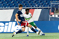 FOXBOROUGH, MA - AUGUST 26: Omar Mohamed #18 of Greenville Triumph SC crosses the ball during a game between Greenville Triumph SC and New England Revolution II at Gillette Stadium on August 26, 2020 in Foxborough, Massachusetts.