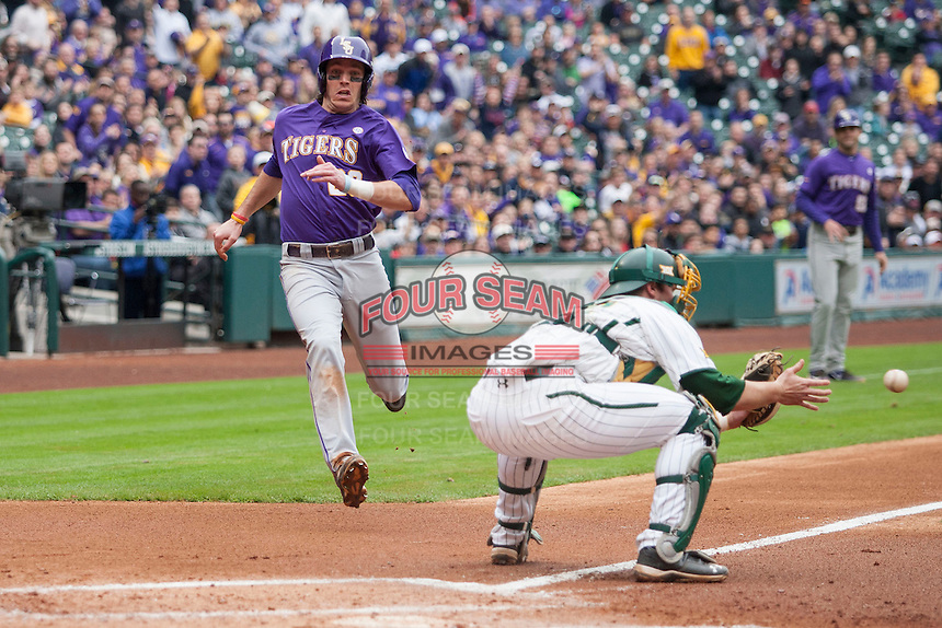 LSU Tigers third baseman Conner Hale (20) sprints home as Baylor catcher Cameron Miller (32) catches the ball during the NCAA baseball game on March 7, 2015 in the Houston College Classic at Minute Maid Park in Houston, Texas. LSU defeated Baylor 2-0. (Andrew Woolley/Four Seam Images)