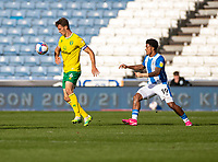 12th September 2020 The John Smiths Stadium, Huddersfield, Yorkshire, England; English Championship Football, Huddersfield Town versus Norwich City;  Christoph Zimmermann (C) of Norwich City controls the high ball as he is tracked by Josh Koroma of Huddersfield Town