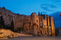 The Pope's Palace in Avignon at sunset. Built in the 14th fourteenth century to house the pope who then resided in Avignon. Flood lit. Avignon, Vaucluse, Provence, Alpes Cote d Azur, France, Europe