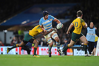 Tomas Lavanini of Argentina is tackled by Tevita Kuridrani of Australia as Bernard Foley of Australia covers during the Semi Final of the Rugby World Cup 2015 between Argentina and Australia - 25/10/2015 - Twickenham Stadium, London<br /> Mandatory Credit: Rob Munro/Stewart Communications
