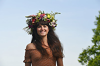 """BNPS.co.uk (01202 558833)<br /> Pic: BNPS<br /> <br /> Pictured Sunday Morning: Kate Southward dons a stunning floral head dress design by Fiona Haser Bizony for the virtual garden day in Faulkland, Somerset.<br /> <br /> Britain's biggest ever 'virtual garden party' is taking place today to help boost the nation's mental wellbeing during the lockdown.<br /> <br /> Participants in Garden Day have donned flower crowns and video-called family and friends while respecting social distancing in the sanctuary of their own gardens.<br /> <br /> The event is being supported by leading gardeners including 13 time RHS Gold medallist Chris Beardshaw.<br /> <br /> Experts are putting on floristry, food and garden tours, as well as live demonstrations on Zoom and Facebook Live.<br /> <br /> Mr Beardshaw said: """"Garden Day is the perfect opportunity for us all to get into our gardens, share our experiences virtually, and participate in a movement that sows the seeds of health, happiness and healing."""