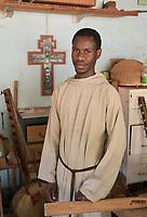 SENEGAL, Benedictine monastery Keur Moussa, monks work in workshop to build the african Kora bridge harp / Senegal, Benediktinerkloster Keur Moussa, Musikinstrumentbau, Werkstatt, Bau der Kora ein traditionelles westafrikanischen Saiteninstrument
