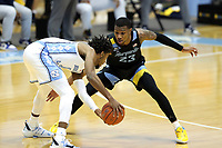 CHAPEL HILL, NC - FEBRUARY 24: Jamal Cain #23 of Marquette defends against Rechon Leaky Black #1 of North Carolina during a game between Marquette and North Carolina at Dean E. Smith Center on February 24, 2021 in Chapel Hill, North Carolina.