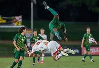 COLLEGE PARK, MD - SEPTEMBER 3: George Mason University defender Jonathan Fawole (27) crashes over Maryland University forward Justin Gielen (9) during a game between George Mason University and University of Maryland at Ludwig Field on September 3, 2021 in College Park, Maryland.