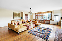 BNPS.co.uk (01202 558833)<br /> Pic: Hamptons/BNPS<br /> <br /> Pictured: A living room.<br /> <br /> An incredible Arts and Crafts country house with its own vineyard is on the market for offers over £7m.<br /> <br /> The Grade II listed St Joseph's Hall is a striking 111-year-old property that was home to the Bishop of Arundel for 40 years.<br /> <br /> It has a wealth of period features, an indoor swimming pool and seven acres of vineyard with mostly Chardonnay grapes, which the owners sell to a local winery.<br /> <br /> The house in Storrington, West Sussex, has 17 acres of land with beautiful views over the South Downs.